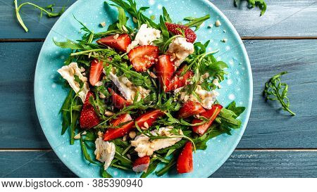 Close Up Salad With Arugula, Strawberries And Cheese Brie, Camembert. Healthy Food Diet Food Concept