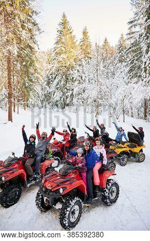 Yaremche, Ukraine - February 02, 2020: Group Of Cheerful People Sitting On Four-wheelers Atv Bikes,