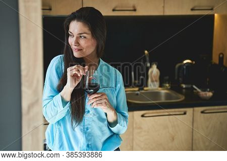 Dreamy Lady With A Wineglass Looking Away