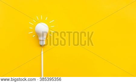 Business Creativity And Inspiration Concepts With Lightbulb And Pencil On Yellow Background. Motivat