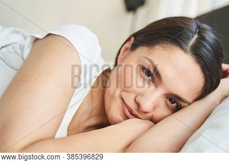 Serene Young Woman Smiling After Waking Up