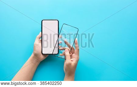 Female Hand Changing Tempered Glass Shield Or Film Screen Cover With Mobile Phone.protection And Saf