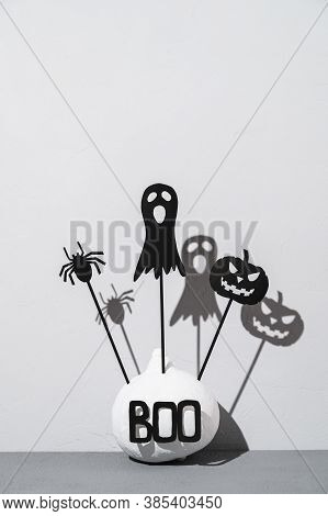 Halloween Home Decorations. Painted White Pumpkin And Black Scary Halloween Shadow Puppets On Sticks