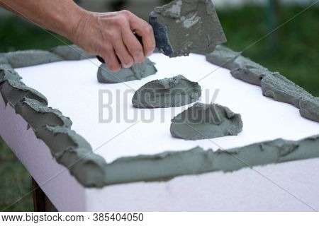 Wall Insulation With Polystyrene Panels, Glue Application And Installation.