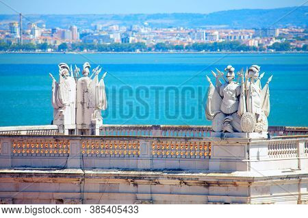 Sculptures Of Knights On The Top Of Arco Da Rua Augusta In Lisbon