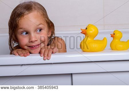Cute Happy Baby Girl Taking Bath With Foam And Toys, Childs Hygiene, Healthy Lifestyle, Carefree Chi