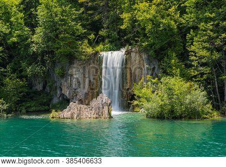 Beautiful Waterfall In The Plitvice Lakes. Sunny Day. Plitvice Lakes, Croatia.