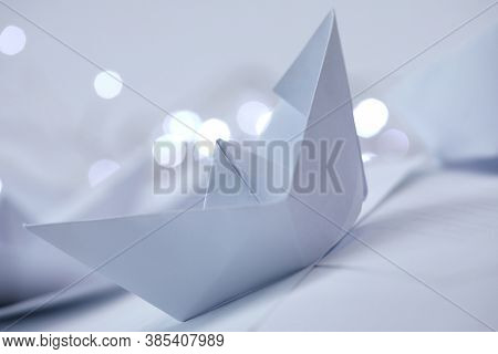 paper boats with lights, macro