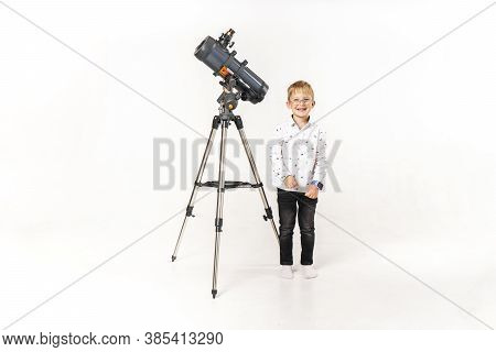 Little Boy With A Large Telescope On A White Background.