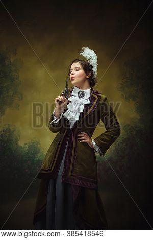 Shoting Gun. Modern Trendy Look, Portrait Of Renaissance Period Beautiful Woman. Retro Style, Compar