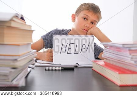 Learning Difficulties, School, Quarantine Education Concept. Tired Frustrated Boy Sitting At Table W