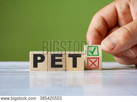 The Hand Turn Wooden Block With Red Reject X And Green Confirm Tick As Change Concept Of Pet. Word P