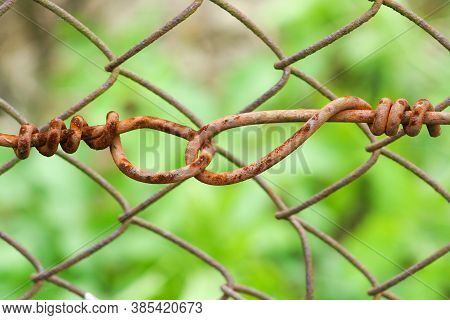 Old Rust Metal Fence As Protection Grid Concept.