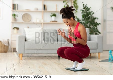 Weight Loss Failure. Unhappy Black Woman Shouting Standing On Weight-scales Indoors. Blank Space For