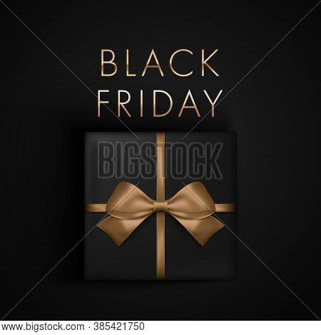 Black Friday Sale Present Box With Gold Ribbon Bow, View From Above. Banner, Poster, Golden Text Col