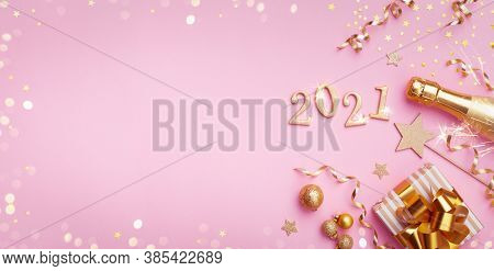 Champagne Bottle, Golden Gift Or Present Box, 2021 Number And Confetti On Pink Background Top View.
