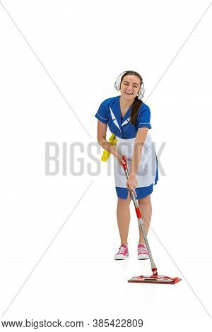 Listening Music During Work. Portrait Of Made, Housemaid, Cleaning Worker In White And Blue Uniform