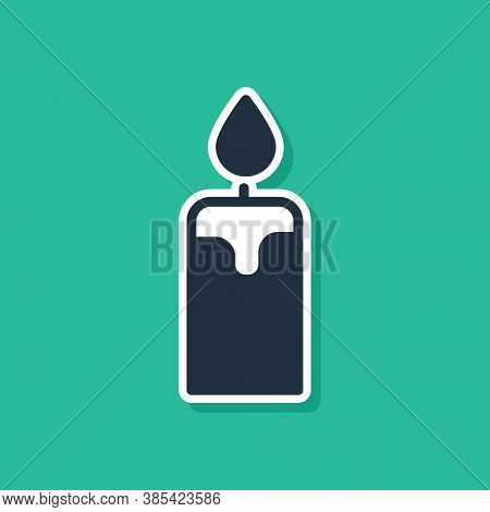 Blue Burning Candle Icon Isolated On Green Background. Cylindrical Candle Stick With Burning Flame.