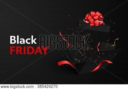 On A Dark Background, Red-white Inscription Black Friday. Flying Confetti And Tinsel From An Explodi
