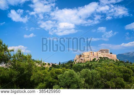 Beautiful View Of Acropolis Hill In Athens, Greece From Pnyx Hill In Summer Day With Great Clouds In
