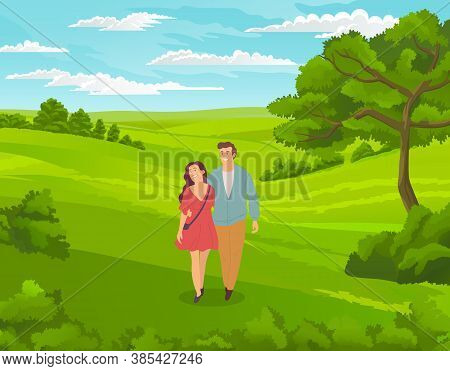 Happy Young Couple Guy And Girl Walking At Nature. In Love People Spend Leisure Time Together Outdoo