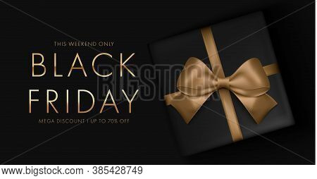 Black Friday Sale Background With Gift Box And Golden Ribbon Bow. Mega Discount Luxury Gold And Whit