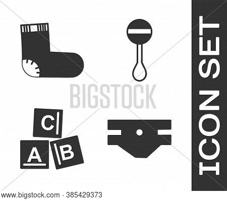 Set Baby Absorbent Diaper, Baby Socks Clothes, Abc Blocks And Rattle Baby Toy Icon. Vector
