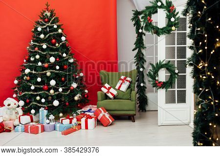 Beautiful Christmas Living Room With Decorated Christmas Tree, Gifts And Fireplace. The Idea For Pos