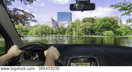 Driving A Car In Towards The Scenic Boston Public Garden, Usa