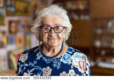 Portrait of an elderly woman at home