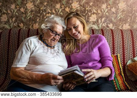 Granny showing her granddaughter memories from the past