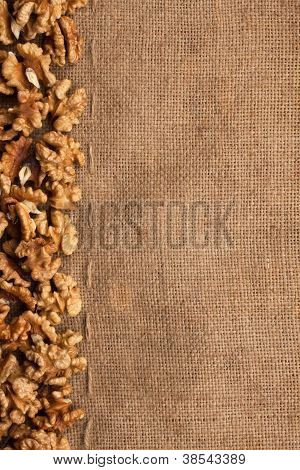 The walnut lying on sackcloth can use as background