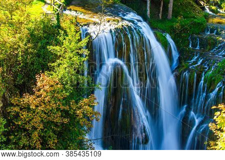 Travel to Croatia. The town of Slunj. Magnificent cascade of waterfalls on the Korana River. Magnificent forests surround the city and the river. The concept of ecological, active and photo tourism