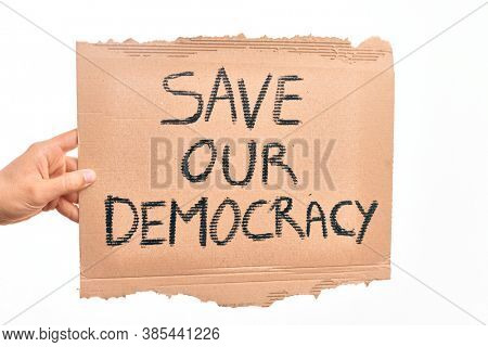 Cardboard banner with SAVE OUT DEMOCRACY text asking for political rights over isolated white background