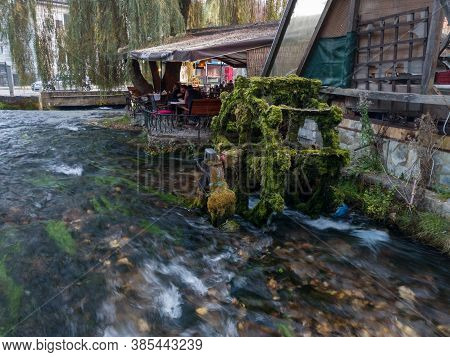 Travnik, Bosnia And Herzegovina - October 26, 2019: An Old Mill Wheel Covered With Moss On The Plava