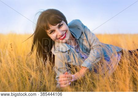 Portrait Of A Woman In The Yellow Steppe Grass.