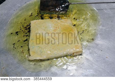 Martabak Telor Or Omelette Martabak. Savoury Pan-fried Pastry Stuffed With Egg, Meat And Spices. Tra