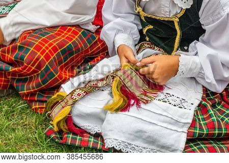 Girl Dressed In Traditional Clothes Lithuanian. Lithuanian National Dress Ornament