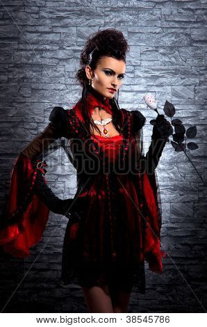 Halloween concept: young and sexy lady vampire in the dungeon poster