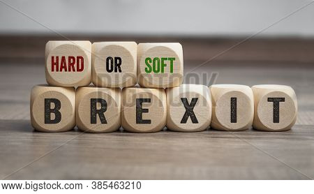 Cubes Or Dice With Hard Or Soft Brexit On Wooden Background
