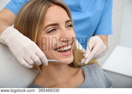 Doctor Examining Patient's Teeth In Clinic, Closeup. Cosmetic Dentistry