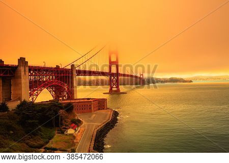 Smoky Orange Sky On Golden Gate Bridge Of San Francisco Skyline From Fort Point. Californian Fires I