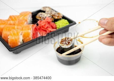 Take Away Sushi In Plastic Containers, Philadelphia Rolls And Unagi Maki, Soy Sauce, Pink Ginger, Wa