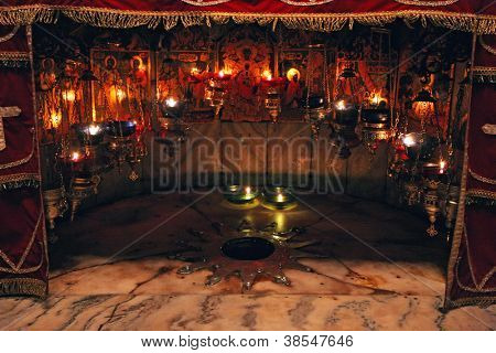 BETHLEHEM - OCTOBER 05: A silver star marks the traditional site of the birth of Jesus in a grotto underneath Bethlehem's Church of the Nativity, Bethlehem, Israel on October 05, 2006.