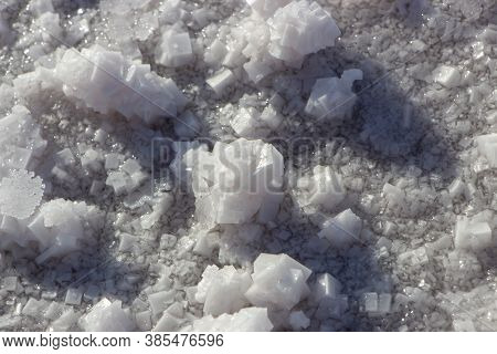 Salt Crystals Formed On The Shores Of The Pink Salt Lake. Pink Background With The Texture Of Salt C