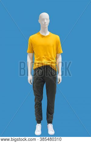 Full-length Male Mannequin Dressed In Fashionable Clothes, Isolated On Blue Background. No Brand Nam