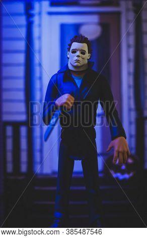 SEPTEMBER 13 2020: Halloween slasher Michael Myers lurking on his porch - Neca Toony Terrors action figure