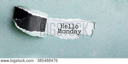 The Text Hello Monday Appearing Behind Torn Brown Paper