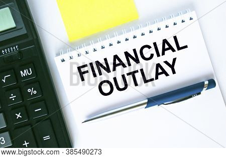 Notepad With Text Financial Outlay. Calculator, Pen And Stickers