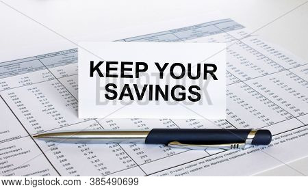 Text Keep Your Savings On White Card With Blue Metal Pen On Financial Table